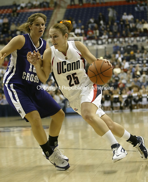 STORRS, CT, 11/09/07- 111407BZ09- UConn's Mel Thomas (25) drives past Holy Cross's Alyssa May (10) during the first half of their game at gampel Pavilion Wednesday night.<br /> Jamison C. Bazinet Republican-American