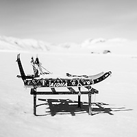 A dog sled called 'Aloha' on a wooden frame in Mestersvig. Mestersvig is a military outpost with a runaway in the Scoresby Land region of the Northeast Greenland National Park. Originally built in anticipation of mining in the area it has been run by the Danish defence department since 1988. The place is staffed by two men whose duties include maintenance of buildings and the airfield and support of other activities in the area.