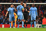 Vincent Kompany of Manchester City questions the referee following Munich's second goal - Manchester City vs. Bayern Munich - UEFA Champion's League - Etihad Stadium - Manchester - 25/11/2014 Pic Philip Oldham/Sportimage