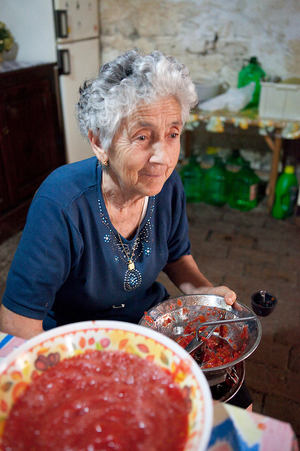 An Italian woman making tomato sauce in Noepoli, Basilicata, Italy, Europe