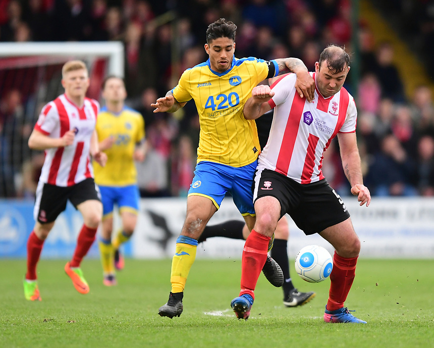 Lincoln City's Matt Rhead shields the ball from Torquay United's Aman Verma<br /> <br /> Photographer Chris Vaughan/CameraSport<br /> <br /> Vanarama National League - Lincoln City v Torquay United - Friday 14th April 2016  - Sincil Bank - Lincoln<br /> <br /> World Copyright &copy; 2017 CameraSport. All rights reserved. 43 Linden Ave. Countesthorpe. Leicester. England. LE8 5PG - Tel: +44 (0) 116 277 4147 - admin@camerasport.com - www.camerasport.com