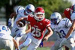 SIOUX FALLS, SD, AUGUST 27:  Jaden Julius #25 from Sioux Falls Lincoln looks for running room past a host of defenders including Sam Galster #13 from Rapid City Stevens in the first half of their game Saturday night at Howard Wood Field. (Photo by Dave Eggen/Inertia)