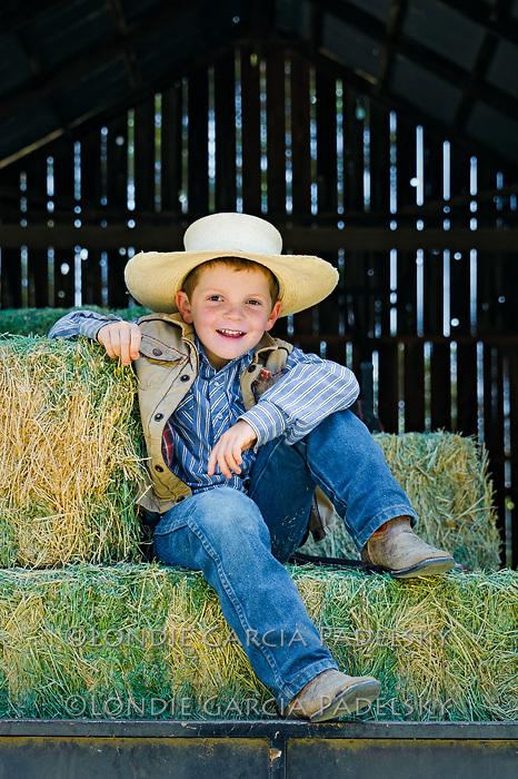 Country boy in the hay barn, San Luis Obispo, California
