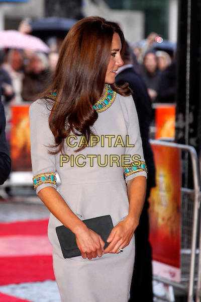 Catherine, Duchess of Cambridge.'African Cats' UK Premiere at BFI Southbank, London, England..25th April 2012.half length kate royals royalty grey gray dress turquoise gold beads beaded profile clutch bag.CAP/AH.©Adam Houghton/Capital Pictures.