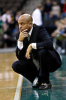 February 08, 2011:    Jacksonville Dolphins head coach Cliff Warren watches the play during Atlantic Sun Conference action between the Jacksonville Dolphins and the North Florida Ospreys at Veterans Memorial Arena in Jacksonville, Florida.  Jacksonville defeated North Florida 71-69.