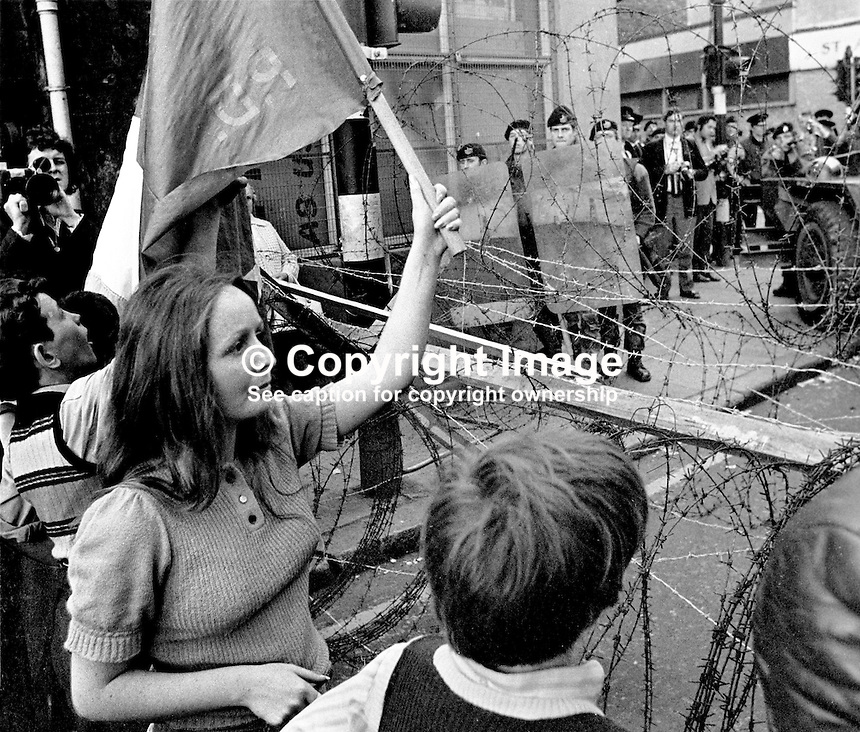 People's Democracy supporters are halted by soldiers and police from entering the city centre in Belfast, N Ireland. The march was in support of PD leaders Michael Farrell and Tony Canavan who were on hunger strike seeking political status in Belfast's Crumlin Road Jail. 29 July 1973, 197307290522c<br /> <br /> Copyright Image from Victor Patterson, 54 Dorchester Park, <br /> Belfast, UK, BT9 6RJ<br /> <br /> t1: +44 28 9066 1296 (from Rep of Ireland 048 9066 1296)<br /> t2: +44 28 9002 2446 (from Rep of Ireland 048 9002 2446)<br /> m: +44 7802 353836<br /> <br /> e1: victorpatterson@me.com<br /> e2: victorpatterson@gmail.com<br /> www.victorpatterson.com<br /> <br /> Please see my Terms and Conditions of Use at www.victorpatterson.com. It is IMPORTANT that you familiarise yourself with them.<br /> <br /> Images used on the Internet must be visibly watermarked i.e. &copy; Victor Patterson<br /> within the body of the image and copyright metadata must not be deleted. Images <br /> used on the Internet have a size restriction of 4kbs and will be chargeable at current<br />  NUJ rates unless agreed otherwise.<br /> <br /> This image is only available for the use of the download recipient i.e. television station, newspaper, magazine, book publisher, etc, and must not be passed on to any third <br /> party. It is also downloaded on condition that each and every usage is notified within 7 days to victorpatterson@me.com<br /> <br /> The right of Victor Patterson to be identified as the author is asserted in accordance with The Copyright Designs And Patents Act (1988).