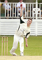 Joe Burke bowls for North London during the Middlesex County Cricket League Division Three game between North London and South Hampstead at Park Road, Crouch End on Sat June 21, 2014.