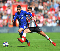 Southampton's Shane Long (right) battles with Chelsea's Eden Hazard (left)<br /> <br /> Photographer David Horton/CameraSport<br /> <br /> The Premier League - Southampton v Chelsea - Saturday 14th April2018 - St Mary's Stadium - Southampton<br /> <br /> World Copyright &copy; 2018 CameraSport. All rights reserved. 43 Linden Ave. Countesthorpe. Leicester. England. LE8 5PG - Tel: +44 (0) 116 277 4147 - admin@camerasport.com - www.camerasport.com
