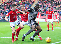 Lincoln City's John Akinde shields the ball from Crewe Alexandra's Ryan Wintle, left, and Paul Green<br /> <br /> Photographer Andrew Vaughan/CameraSport<br /> <br /> The EFL Sky Bet League Two - Crewe Alexandra v Lincoln City - Wednesday 26th December 2018 - Alexandra Stadium - Crewe<br /> <br /> World Copyright &copy; 2018 CameraSport. All rights reserved. 43 Linden Ave. Countesthorpe. Leicester. England. LE8 5PG - Tel: +44 (0) 116 277 4147 - admin@camerasport.com - www.camerasport.com