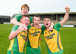 Inagh-Kilnamona players Tom Barry, Cillian Roughan, Eoin Fitzgerald and Cian Mc Inerney celebrate in the rain  following their Minor A county final win over Kilmaley at Cusack Park. Photograph by John Kelly.