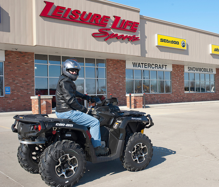 16 February 2012 --  Can-Am ATV Giveaway. Jason Moore of Omaha picks up his Can-Am ATV that he won as prize in Can-Am 4x4x4x4 Sweepstakes. Moore picked up his ATV at Leisure Life Sports in Omaha, Neb.. Picture by Daniel Johnson (Copyright 2012 Daniel Johnson)