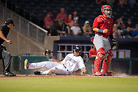 Northwest Arkansas Naturals outfielder Blake Perkins (44) safely slides into home for a run on May 16, 2019, at Arvest Ballpark in Springdale, Arkansas. (Jason Ivester/Four Seam Images)