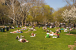 New York City, New York: People enjoying spring sunshine in Washington Square in Greenwich Village  .Photo #: ny312-15152  .Photo copyright Lee Foster, www.fostertravel.com, lee@fostertravel.com, 510-549-2202.