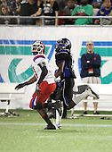 First Coast Buccaneers wide receiver Christopher Black #1 goes down field on a pass route covered by Brent Yancy #31 (white jersey) during the fourth quarter of the Florida High School Athletic Association 7A Championship Game at Florida's Citrus Bowl on December 16, 2011 in Orlando, Florida.  Manatee defeated First Coast 40-0.  (Photo By Mike Janes Photography)