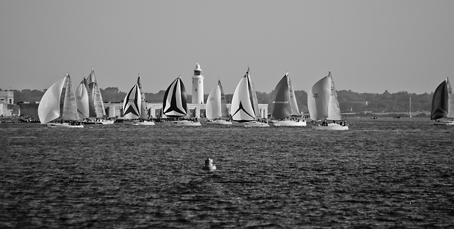 The world's largest and most famous yachting race, the 'JP Morgan Asset Management Round the Island Race, took place on the 19th June 2010, starting in Cowes, Isle of Wight, England.The world's largest and most famous yachting race, the 'JP Morgan Asset Management Round the Island Race, took place on the 19th June 2010, starting in Cowes, Isle of Wight, England. <br /> <br /> I managed to catch it as the main fleet passed Colwell, Totland and Freshwater at the western tip of the island.