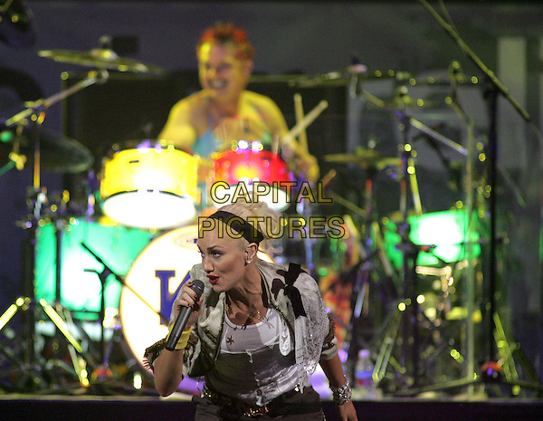 NO DOUBT -  GWEN STEFANI.Live at The Music for Relief Tsunami Benefit Concert held at The Pond of Anaheim in Anaheim, California   .February 18th, 2005.half length stage gig singing dancing  .www.capitalpictures.com.sales@capitalpictures.com.Supplied by Capital PIctures
