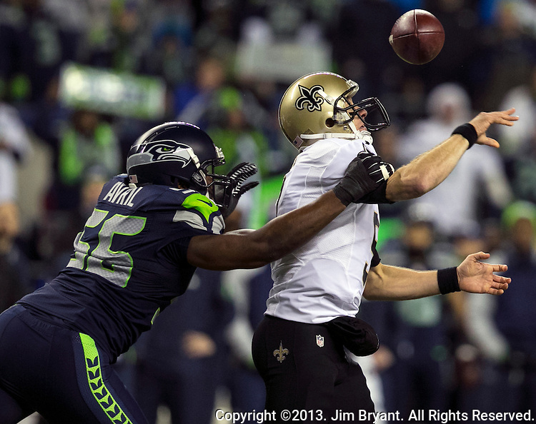 Seattle Seahawks  defensive end Chris Avril (56) strips New Orleans Saints quarterback Drew Brees (8) of the ball during the first quarter at CenturyLink Field in Seattle, Washington on December 2, 2013. Seahawks defensive end Michael Bennett caught the ball and returned it for a touchdown. The Seahawks lead the Saints 27-7 at the half.©2013. Jim Bryant Photo. ALL RIGHTS RESERVED.