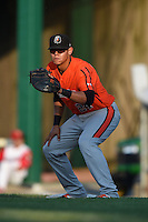 Aberdeen IronBirds first baseman Cory Segui (24) holds a runner on during a game against the Williamsport Crosscutters on August 4, 2014 at Bowman Field in Williamsport, Pennsylvania.  Aberdeen defeated Williamsport 6-3.  (Mike Janes/Four Seam Images)