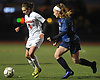 Alexa Verni #6 of Patchogue-Medford, left, gets pressured by Olivia Curry #14 of Farmingdale during Game 1 of two Long Island varsity girls soccer senior all-star games at Farmingdale State College on Friday, Nov. 24, 2017.