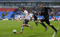 Bolton Wanderers' Adam Le Fondre tries to create space as Northampton Town's Adam Smith races back to his goal<br /> <br /> Photographer Alex Dodd/CameraSport<br /> <br /> The EFL Sky Bet League One - Bolton Wanderers v Northampton Town - Saturday 18th March 2017 - Macron Stadium - Bolton<br /> <br /> World Copyright &copy; 2017 CameraSport. All rights reserved. 43 Linden Ave. Countesthorpe. Leicester. England. LE8 5PG - Tel: +44 (0) 116 277 4147 - admin@camerasport.com - www.camerasport.com