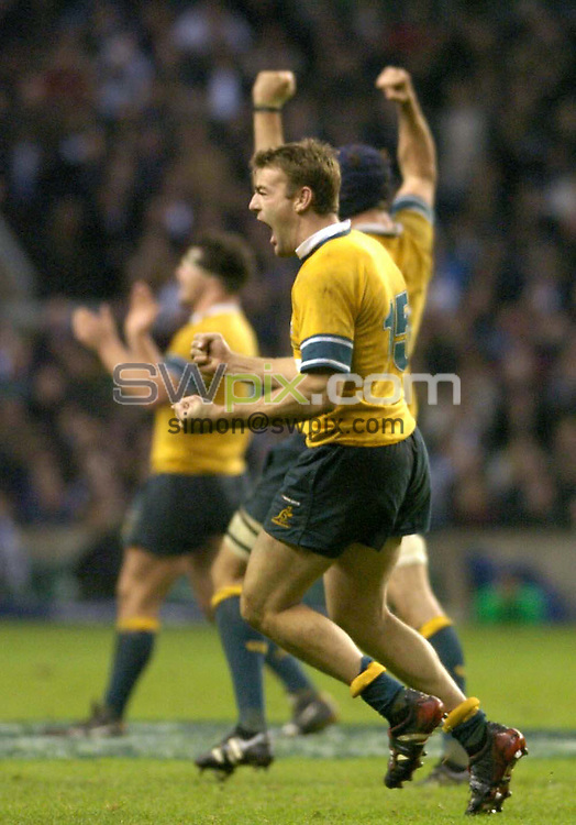 Pix by BEN DUFFY/SWpix.com......International rugby Union - England v Australia...27/11/04..Picture Copyright >> Simon Wilkinson >> 07811267706..Australia's Chris Latham jumps for joy after beating England