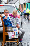 Jack O'Shea & Emma Quigley set up their own water stop in New Street Cahersiveen for the Ring of Kerry Cyclists.