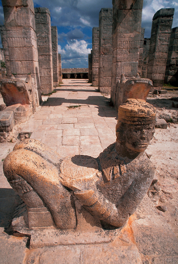 A sculpture and colonnade at an ancient Mayan ruin. Tulum Quintana Roo, Mexico.