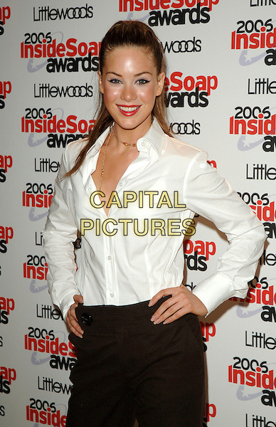 ROXANNE McKEE.The 2006 Inside Soap Awards at Floridita..25th September 2006  London, England.half length white blouse shirt hands on hips.CAP/BEL.© Tom Belcher/Capital Pictures.