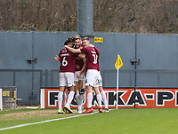 5th January 2020; Pirelli Stadium, Burton Upon Trent, Staffordshire, England; English FA Cup Football, Burton Albion versus Northampton Town; Charlie Goode of Northampton Town celebrates with his team after scoring in the 46th minute of the first half to take a 0-3 lead - Strictly Editorial Use Only. No use with unauthorized audio, video, data, fixture lists, club/league logos or 'live' services. Online in-match use limited to 120 images, no video emulation. No use in betting, games or single club/league/player publications