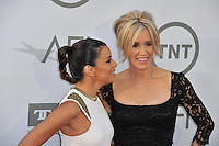 Eva Longoria &amp; Felicity Huffman at the 2014 American Film Institute's Life Achievement Awards honoring Jane Fonda, at the Dolby Theatre, Hollywood.<br /> June 5, 2014  Los Angeles, CA<br /> Picture: Paul Smith / Featureflash
