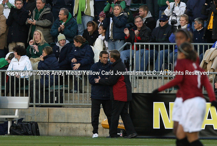 05 December 2008: Notre Dame head coach Randy Waldrum (left) and Stanford head coach Paul Ratcliffe (right) shake hands before the game. The Notre Dame Fighting Irish defeated the Stanford Cardinal 1-0 at WakeMed Soccer Park in Cary, NC in an NCAA Division I Women's College Cup semifinal game.