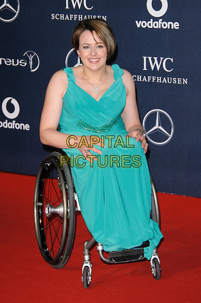 Tanni Grey-Thompson.Arrivals at the Laureus 2012 World Sports Awards held at the Queen Elizabeth II Centre, London, England..February 6th, 2012.full length green dress sitting wheelchair .CAP/CJ.©Chris Joseph/Capital Pictures.