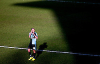 Michael Harriman of Wycombe Wanderers amongst the shadows of the Adams Stand at the final whistle during the Sky Bet League 2 match between Wycombe Wanderers and Mansfield Town at Adams Park, High Wycombe, England on 25 March 2016. Photo by Andy Rowland.