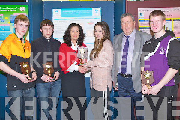WINNERS: Students from the leaving cert class of Scoil Phobail Sliabh Luachra, Rathmore who were the Team maths 2013 Regional Round winners and were presented with their trophy's from Caitriona Ní Chullota (Director of the Eduaction Centre,Dromtacker,Tralee) on Friday evening up in The ITT South Campus Tralee,and they will repersent their school in Cork .l-r: Chris O'Leary, Asdhley Campion, Caitríona Ná Cullota (Dir Education Centre, Dromtacker, Tralee), Caitriona O'Sullivan (John O'Regan (Quiz Mentor) and Andrew McC Carthy.