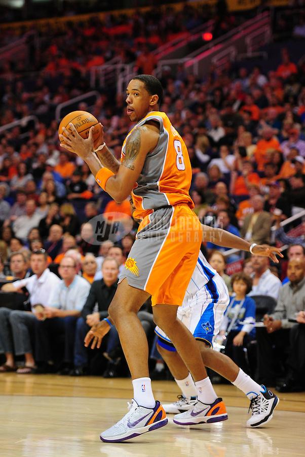 Mar. 25, 2011; Phoenix, AZ, USA; Phoenix Suns center (8) Channing Frye against the New Orleans Hornets at the US Airways Center. The Hornets defeated the Suns 106-100. Mandatory Credit: Mark J. Rebilas-.