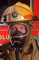 Firefighter in protective gear.