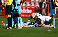 Ryan Sellers of Wycombe Wanderers lays motionless on the floor after a challenge from Clinton Morrison of Exeter City during the Sky Bet League 2 match between Exeter City and Wycombe Wanderers at St James' Park, Exeter, England on 26 September 2015. Photo by Pinnacle Photo Agency.