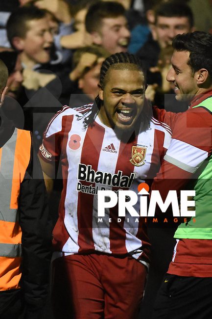 Luke Benbow emerges from the crowd after celebrating his free-kick goal making it 3-0 during the FA Cup 1st round replay match between Stourbridge and Whitehawk  at the War Memorial Athletic Ground, Stourbridge, England on 14 November 2016. Photo by Garry Griffiths.