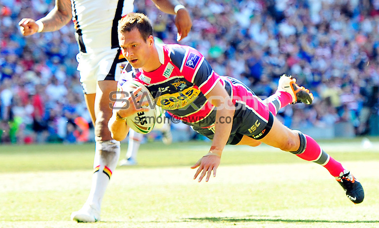 Picture by Simon Wilkinson/SWpix.com 27/05/2012 - Rugby League Stobart Super League Magic Weekend  Etihad Stadium Manchester. Bradford Bulls v Leeds Rhinos.copyright picture..simon wilkinson..simon@swpix.com.Leeds Danny Mcguire  goes over for the third of his scores