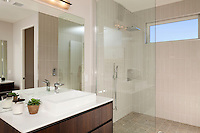 Stock photo of modern bathroom with vanity and walk-in shower
