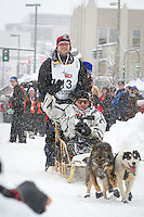 Michael Suprenant leaves the 2011 Iditarod ceremonial start line in downtown Anchorage, during the 2012 Iditarod..Jim R. Kohl/Iditarodphotos.com
