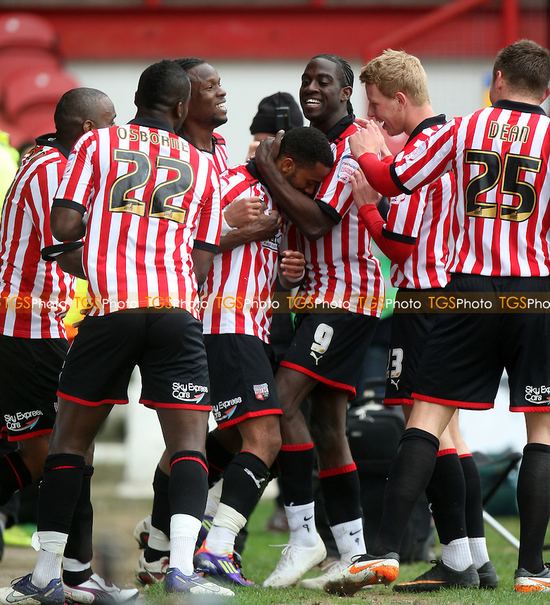 Shaleum Logan of Brentford is congratulated for scoring the third goal -  Brentford vs Bury - at the Griffin Park Stadium - 07/04/12 - MANDATORY CREDIT: Dave Simpson/TGSPHOTO - Self billing applies where appropriate - 0845 094 6026 - contact@tgsphoto.co.uk - NO UNPAID USE.