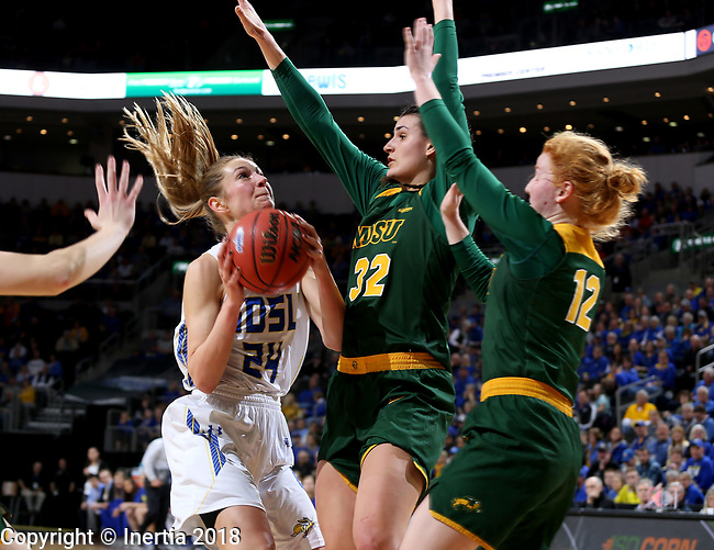 SIOUX FALLS, SD - MARCH 3:  SDSU's Tagyn Larson #24 gets guarded heavily by two NDSU players at the 2018 Summit League Basketball tournament at the Denny Sanford Premier Center in Sioux Falls. (Photo by Dave Eggen/Inertia)