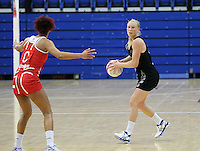 20.1.2014 New Zealand's Laura Lagman competes for the ball with England's Serena Guthrie during their netball test match in London, England. Mandatory Photo Credit (Pic: David Klein). ©Michael Bradley Photography.