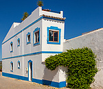 Traditional architecture building style house with whitewashed walls and blue painted features, Cacela Velha, Vila Real de Santo António, Algarve, Portugal, Southern Europe
