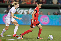 Portland, Oregon - Sunday September 11, 2016: Portland Thorns FC forward Christine Sinclair (12) and Western New York Flash midfielder Samantha Mewis (5) during a regular season National Women's Soccer League (NWSL) match at Providence Park.