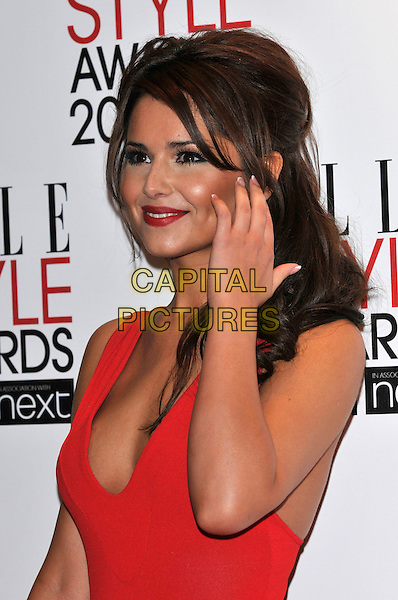 CHERYL COLE.The ELLE Style Awards 2011 at Grand Connaught Rooms, London, England..February 14th, 2011 .half length dress hand red sleeveless low cut cleavage lipstick make-up beauty .CAP/PL.©Phil Loftus/Capital Pictures.