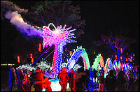 BNPS.co.uk (01202 558833)<br /> Pic: PhilYeomans/BNPS<br /> <br /> A stunning 70m long fire breathing porcelain dragon.<br /> <br /> The largest Chinese 'Festival of Light' seen in Europe is taking shape at the Longleat House in Wiltshire - A small army of over 50 skillled workers have flown in from the remote village of Zigong in central China to create the stunning spectacle.<br /> <br /> Among the different scenes are a 20-metre tall Chinese temple, a 70-metre-long dragon, created using more than 10,000 porcelain cups, bowls, plates and dishes, and the mythical qilin &ndash; a chimerical hooved creature with the head of a lion &ndash; featuring more than 30,000 glass phials filled with coloured liquid.<br /> <br /> Massive traditional Chinese masks are also featured and there is also a bamboo forest which is home to a family of life-size pandas, giant elephants, zebras, lions and deer as well as giant lotus flowers floating on the lake.<br /> <br /> Filled with thousands of LED lights and handmade by a team of 50 highly-skilled craftsmen from Zigong in China's Sichuan province, the lanterns recreate a magical world of myths and legends.<br /> <br /> Set amid the beautiful backdrop of the landscaped grounds and gardens surrounding Longleat House, the lit structures also spill out on to Half Mile Lake to create a stunning and enchanting experience for visitors.<br /> <br /> It&rsquo;s the first time a festival of this size has taken place in the UK and the Chinese team behind the spectacular event believe its size and complexity make it unique throughout Europe.