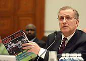 "Washington, D.C. - April 27, 2005 -- Paul Tagliabue, Commissioner, National Football League (NFL), shows off the NFL publication ""Play it Safe: Health Concerns for Young Athletes"" as he testifies before the United States House of Representatives Committee on Government Reform in Washington, D.C. on April 27, 2005.  The commissioner defended the league's drug policies during the hearing ""Steroid Use in Sports Part II: Examining the National Football League's Policy on Anabolic Steroids and Related Substances""..Credit: Ron Sachs / CNP..(RESTRICTION: NO New York or New Jersey Newspapers or newspapers within a 75 mile radius of New York City)"