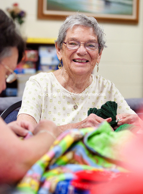 NAUGATUCK, CT-6 July 2012-070912BF03-- Ruth Braziel works on making some hats during a knitting activity at the Naugatuck Senior Center Monday morning. Braziel was one of the seniors helped with chores around her home by the Elks Club Senior Home Work Project. The program offers a helping hand to senior citizens who would like help around their homes. Bob Falcetti Republican-American